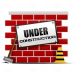 Under Construction Sign on Abstract Brick Wall